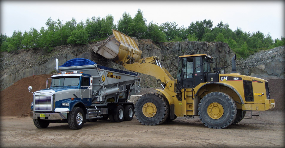 stone slinger truck and excavator